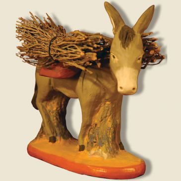 Farmer's donkey with wood bundle
