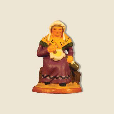 image: Provençal woman making aïoli