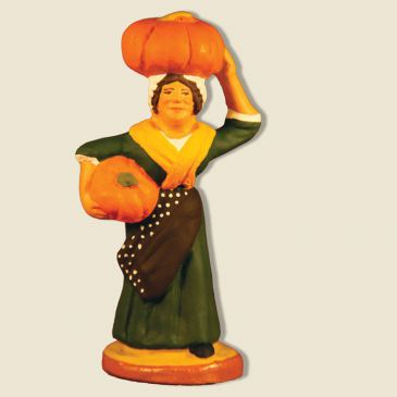 image: Woman carrying pumpkins