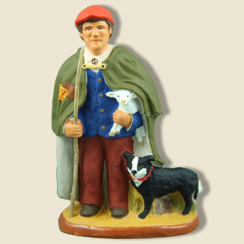 image: Shepherd with lam and dog