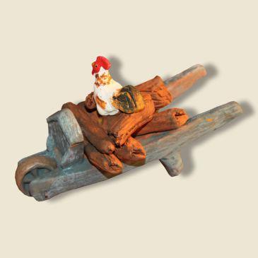 image: Brouette garçon avec bûche de bois et coq