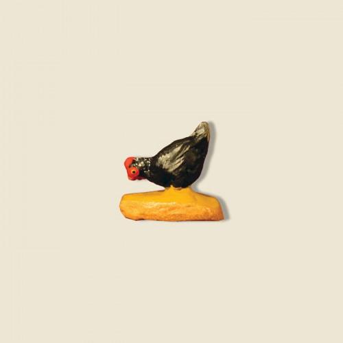 image: Poule noire qui picore