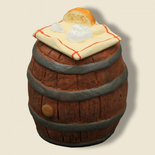 image: Cloth with bread and goat cheese on his Barrel