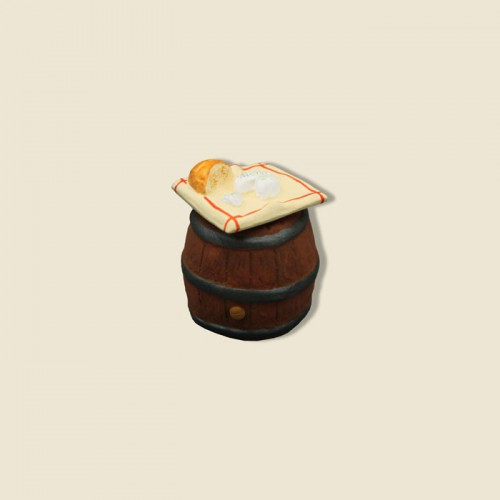 image: Cloth with bread and goat cheese on Barrel