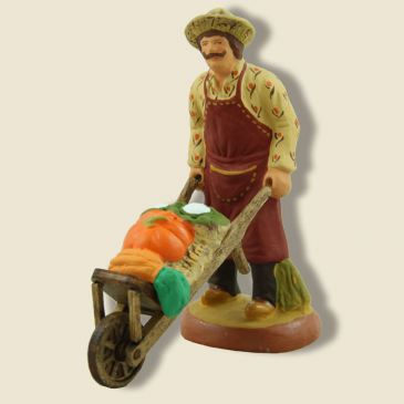 image: Gardener with vegetables on wheelbarrow