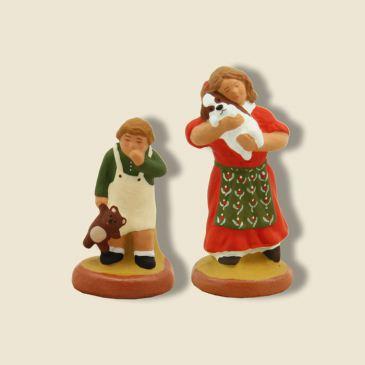 image: Petite fille (rouge) et son frère (vert)
