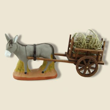 Donkey standing on grass and Wood Cart of harness