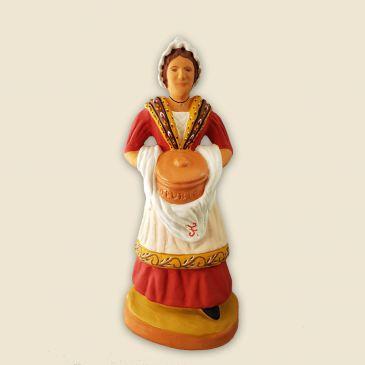 image: Woman carrying provencal dish