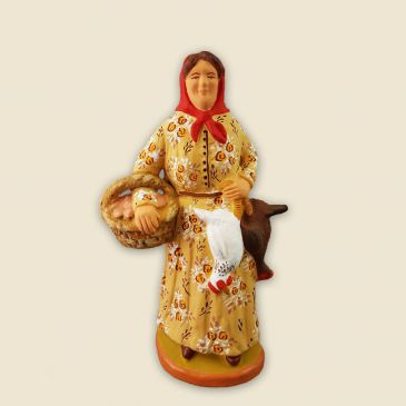image: Woman carrying a hen