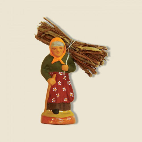 image: Woman carrying wood