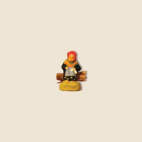 image: Vielle assise sur fagot