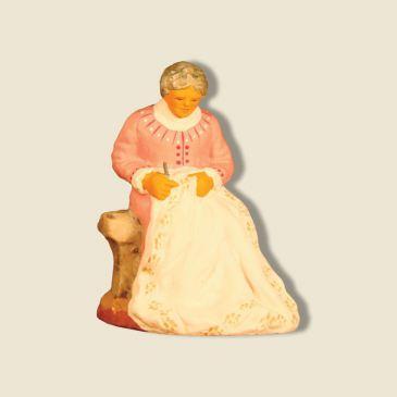 image: Woman embroiding