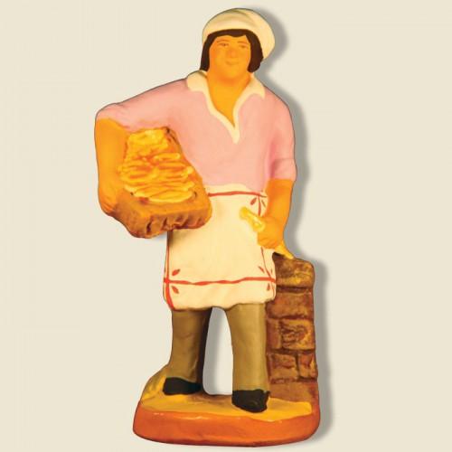"image: Baker making cookies called ""navettes"""