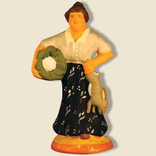 image: Woman carrying cauliflower