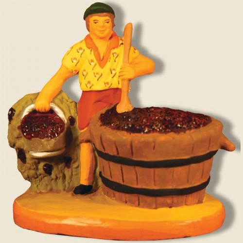 image: Vendangeur avec cuve de raisins