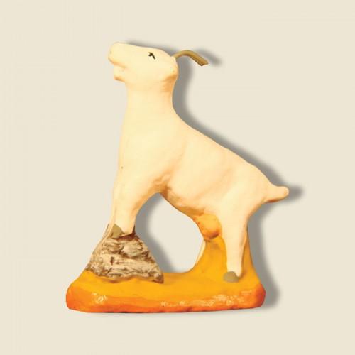 image: Goat standing on a boulder