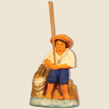 image: Seated fisherman